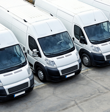 Commercial auto vans parked outside business